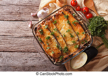 Greek moussaka in baking dish with the ingredients....