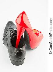 red high heels and men's shoe - ladies shoe on men's shoe,...