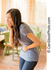 woman has abdominal pain - a young woman has pain in the...