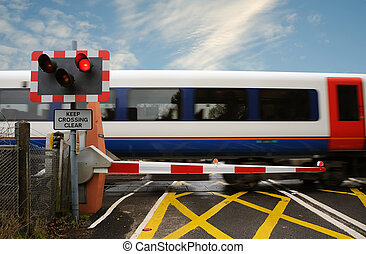 Level crossing - A train passing across a level crossing, on...