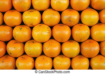 Fresh Oranges background ,Orange honeysuckle species, stack...