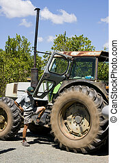 Farmer and tractor. - Old tractor ready to be mounted by the...