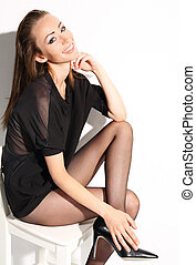 Flexible tights. - Beautiful, leggy woman in thin tights and...