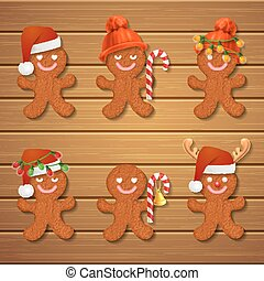 collection of gingerbread man Christmas cookies on wood...