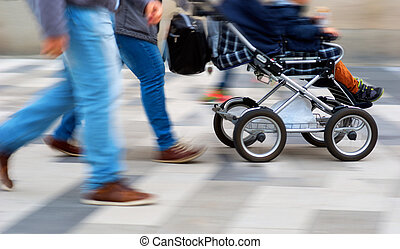 Young parents with pram - Young couple walking with child in...