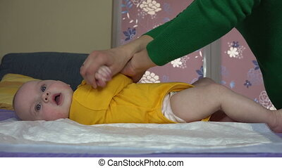 mom exercise baby hands - Careful mom woman make special...