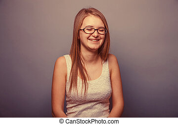 European-looking girl of twenty years with glasses,...