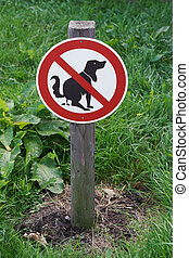 prohibition sign no dog pooping on lawn...