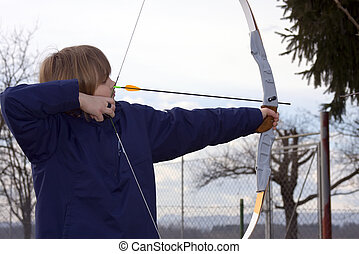 Archer - Boy archer aiming at the target.