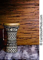 Tam Tam - drum in the background Dark bamboo mat and wooden...
