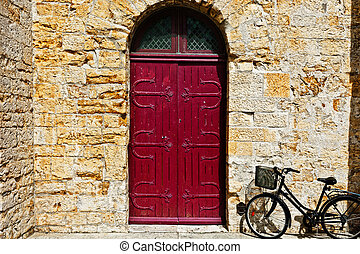French Door - Bike near the Solid Wooden Door in the French...