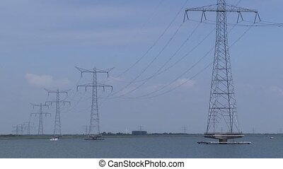 Lake Ketelmeer with raised electricity poles above the water