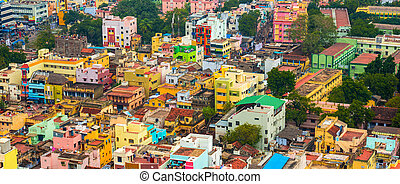 cityscape of colorful homes in crowded Indian city Trichy,...