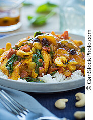 Moroccan Chicken - Moroccan chicken and vegetables over rice...