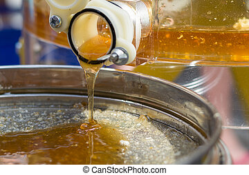 Honey is thrown from honeycomb - Honey extraction by...