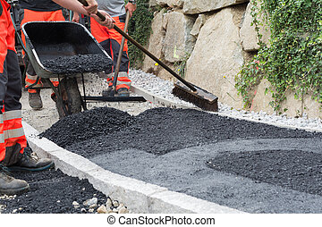 Construction workers at asphalting - several construction...