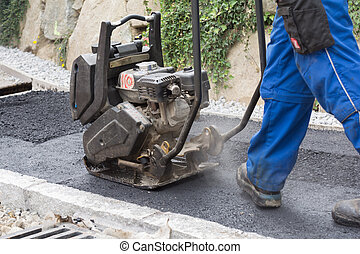 Jogger at sidewalk asphalting - Construction worker with...