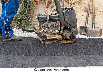 Construction worker with vibrator - Construction workers at...