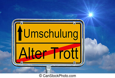 Retraining - sign with the german words Retraining and old...