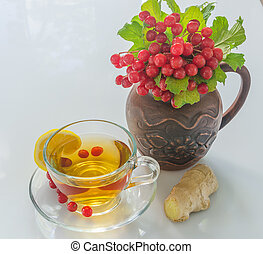 viburnum in a ceramic jug and tea on a white background
