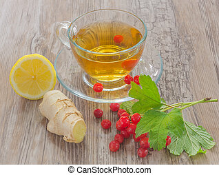 viburnum branch with tea on wooden table