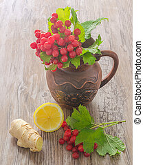 viburnum in a ceramic jug and spice on wooden table