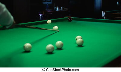 Cue and balls in billiards
