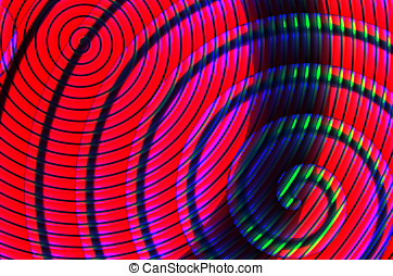 Colorful spirals on a dark background, illustration, art