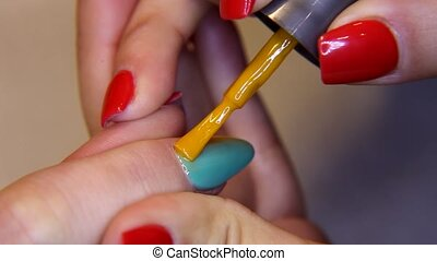 beauty salon, beautiful nails manicure acrylic paint on hand...