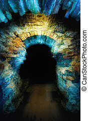 Magical gateway - Ancient stone arch illuminated with blue...