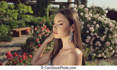 Elegant woman oriental appearance with long hair in a...