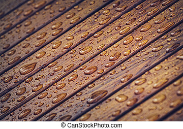 Water drops pattern on wooden material. Tinted colors....