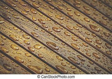 Water drops on wooden floor - Water drops pattern on wooden...