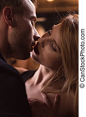 Sensual couple kissing passionately - Close-up of attractive...