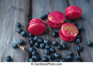 appetizer sweets - fresh macaroons and ripe blackberry on a...