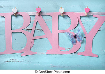 Pink baby girl nursery letters bunting against a vintage aqua blue shabby chic background