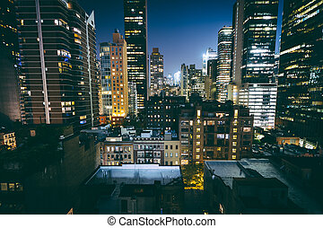 View of buildings in Midtown East at night, in Manhattan,...