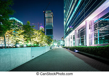 Walkway and buildings at night, in Jersey City, New Jersey