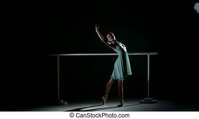 little ballerina on ballet barre