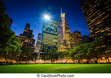 Skyscrapers in Midtown at night, seen at Bryant Park in...