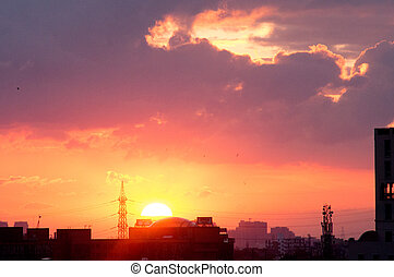 Sunset over gurgaon cityscape with monsoon clouds