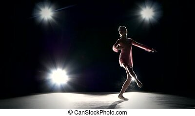 ballet dancer on a grey background Ballerina is wearing...