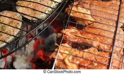 Meat on the grill with flames closeup - salmon fillet on the...