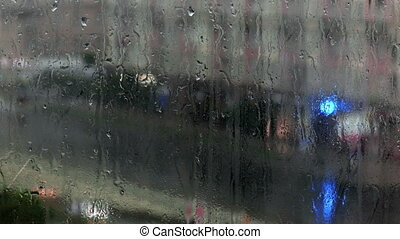 raindrops on a windowpane - raindrops on a window during a...