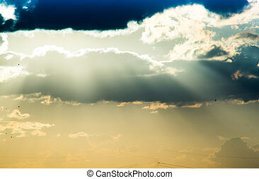 light rays passing through clouds at sunset The individual...