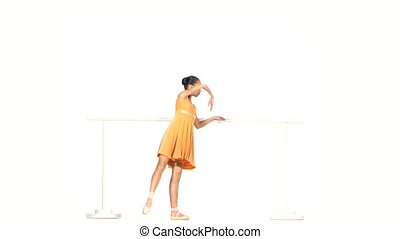 ballet dancer in yellow dress on the dance floor - beautiful...