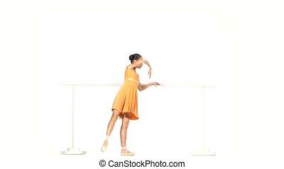 ballet dancer in yellow dress on the dance floor - beautiful...
