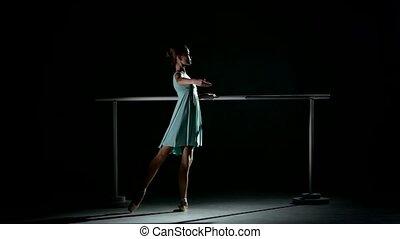 little ballerina in the ballet hall on ballet barre