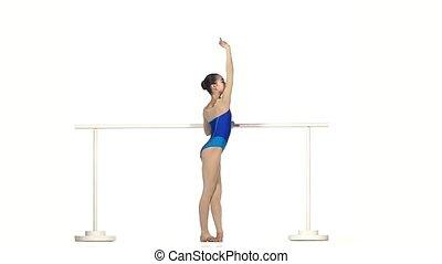 ballet dancer in black dress isolated on white. slow motion...