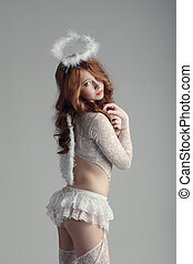 Innocence and sexuality. Girl in angel costume - Innocence...